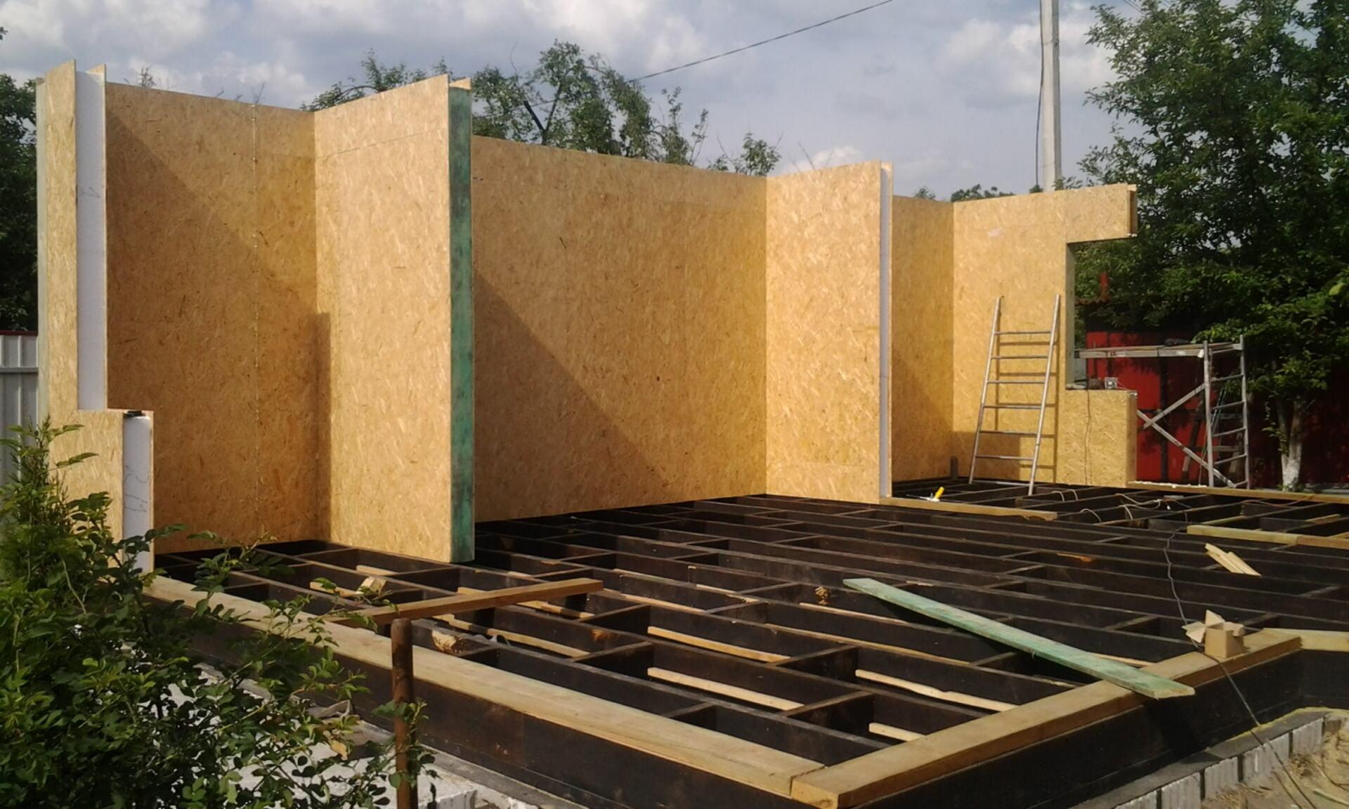Сборка домов по каркасной технологии - фото